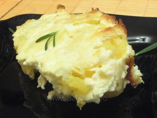 Cartofi cu brânză la cuptor